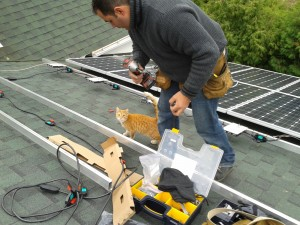 Solar panels being installed on roof of the UU Church of Olinda
